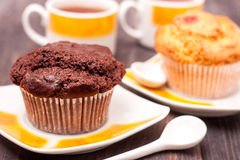 Cupcakes with tea on black wooden background Stock Image