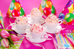 Cupcakes in tea cup shape molds for birthday party Stock Photography