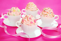 Cupcakes in tea cup shape molds for birthday party Royalty Free Stock Photo