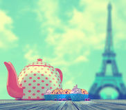 Cupcakes and teapot. Sweet and colourful cupcakes on retro-vintage background Royalty Free Stock Image