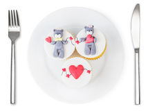 Cupcakes with teddy bear and hearts on plate isolated Stock Photo
