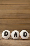 Cupcakes with text dad on arranged wooden plank stock image