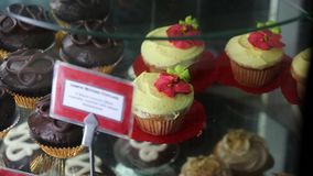 Cupcakes on a three tiered rotating glass display. The most colorful, delicious display of cupcakes you`ve ever seen on a rotating three-tiered glass display stock footage