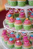 Cupcakes tier. Cute and colorful yummy cupcakes tier Stock Photos