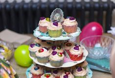 Cupcakes on a 3 tier stand Royalty Free Stock Photos