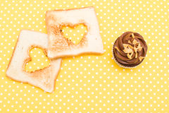 Cupcakes and toast Stock Images