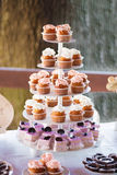 Cupcakes tower at the banquet table Stock Photography