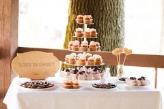 Cupcakes tower at the banquet table Stock Images