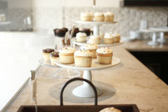 Cupcakes on trays Stock Images