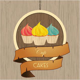 Cupcakes trio on wooden sign with rope details Stock Photos
