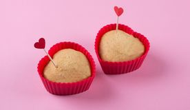 Cupcakes. Two heart- shaped cupcakes in red forms Stock Image
