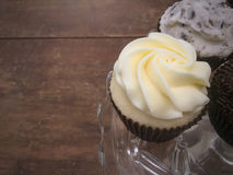 Cupcakes Up Close. On Cake Stand Over Wood Background Stock Photo