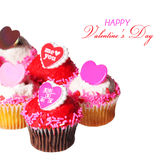 Cupcakes with Valentine hearts on the tops, isolated on white Stock Photo