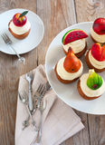 Cupcakes with vanilla buttercream and marzipan fruits Royalty Free Stock Images