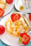 Cupcakes with vanilla cream,caramel and strawberry Stock Image