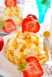 Cupcakes with vanilla cream,caramel and strawberry Royalty Free Stock Image
