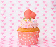 Cupcakes with vanilla frosting and cute hearts Royalty Free Stock Photo