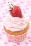 Cupcakes with vanilla frosting and cute red hearts Royalty Free Stock Images