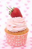 Cupcakes with vanilla frosting and cute red hearts Royalty Free Stock Photo