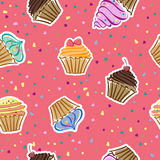 Cupcakes in the vector. Seamless pattern with cupcakes in the vector Stock Photo