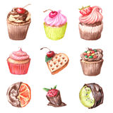 Cupcakes, Viennese wafers, oranges and kiwi fruit in chocolate. Royalty Free Stock Photography