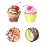 Cupcakes, Viennese wafers, oranges and kiwi fruit in chocolate. Stock Image