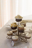Cupcakes on whate table in restaurant Royalty Free Stock Image