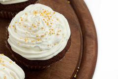 Cupcakes with whipped cream Royalty Free Stock Photography