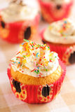 Cupcakes with whipped cream. And icing stock images