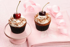 Cupcakes with whipped cream and cherry Royalty Free Stock Images
