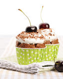 Cupcakes with whipped cream and cherry Stock Images