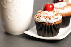Cupcakes with whipped cream and cherry Stock Photo