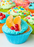Cupcakes with whipped cream decorated fruit and berries Royalty Free Stock Photography