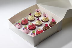 Cupcakes. White box with twelve assorted cupcakes Royalty Free Stock Photos