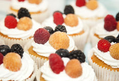 Cupcakes with white cream and berries Stock Photo