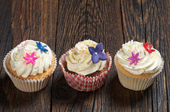Cupcakes with white cream Royalty Free Stock Images
