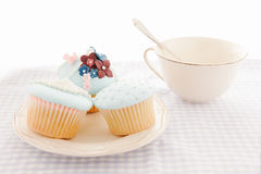 Cupcakes and white cup Royalty Free Stock Photos