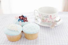 Cupcakes and white cup Stock Photos