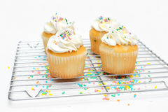 Cupcakes And Wire Cooling Rack Royalty Free Stock Images