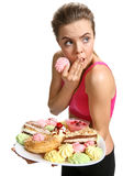 Cupcakes - woman caught eating cupcake snack after running Royalty Free Stock Photo
