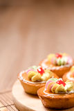 Cupcakes on wood table Stock Images