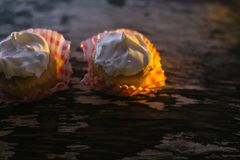 Cupcakes on a wooden background in the sunlight Stock Photography