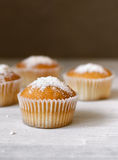 Cupcakes on a wooden table Stock Images