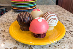 Cupcakes on Yellow Dessert Plate Closeup Royalty Free Stock Images
