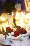 Cupcakes, yum. Strawberry cupcakes, background candles are blown out Stock Image