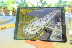 Apple Park new campus. Cupertino, CA, United States - August 12, 2018: details of iPad with virtual reality program showing the new Apple Offices and the royalty free stock photos