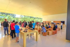 Apple Store California. Cupertino, CA, United States - August 12, 2018: interior with many customers in the new Apple store and Headquarters of Apple Park royalty free stock image