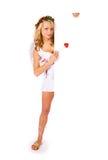 Cupid: Στάση πίσω από την άσπρη κάρτα Στοκ εικόνες με δικαίωμα ελεύθερης χρήσης