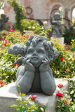 Cupid στον κήπο Στοκ Εικόνες