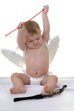 Cupid. Little baby Cupid getting his bow and arrow ready to shoot stock images